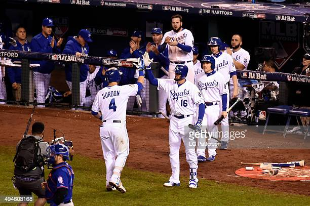 Alex Gordon of the Kansas City Royals is greeted in the dugout after hitting a game tying home run in the bottom of the ninth inning of Game 1 of the...