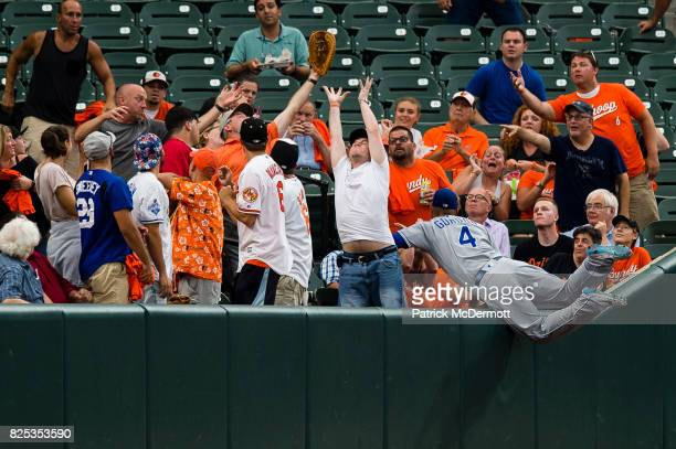 Alex Gordon of the Kansas City Royals is unable to catch a foul ball hit by Adam Jones of the Baltimore Orioles in the second inning during a game at...
