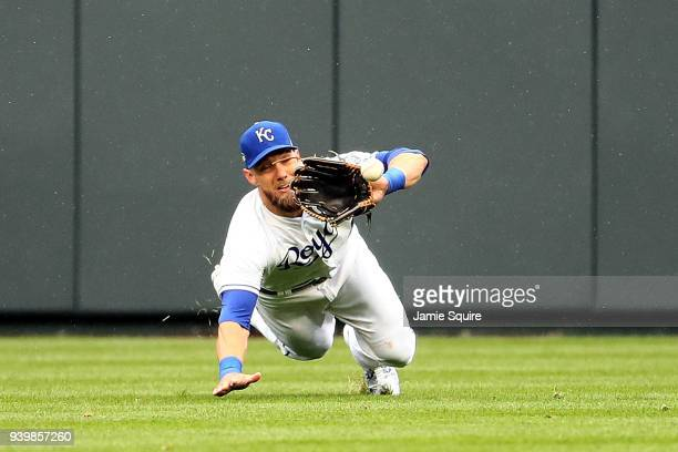 Alex Gordon of the Kansas City Royals makes a diving catch during the game against the Chicago White Sox on Opening Day at Kauffman Stadium on March...