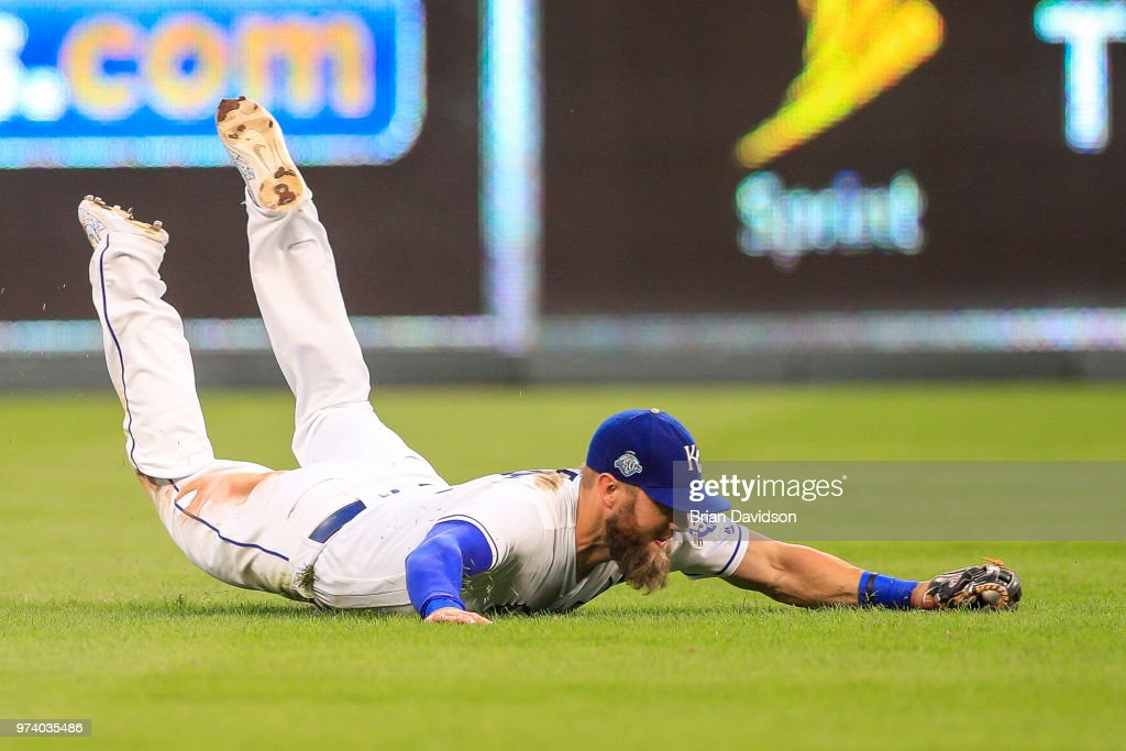 Alex Gordon #4 of the Kansas City Royals makes a play against the Cincinnati Reds during the sixth inning at Kauffman Stadium on June 13, 2018 in Kansas City, Missouri.