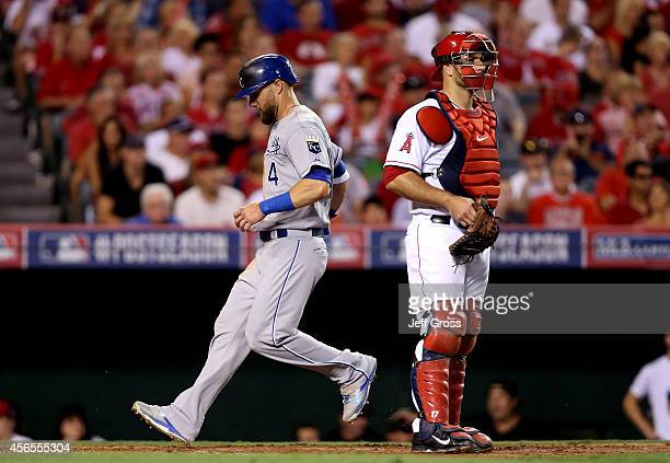 Alex Gordon of the Kansas City Royals scores on a sacrifice fly in the fifth inning against the Los Angeles Angels during Game One of the American...