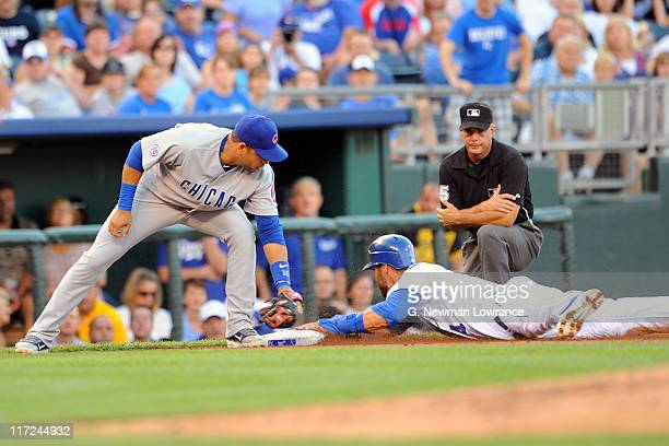 Alex Gordon of the Kansas City Royals slides in with a stolen base as Aramis Ramirez of the Chicago Cubs attempts to make the tag at Kauffman Stadium...