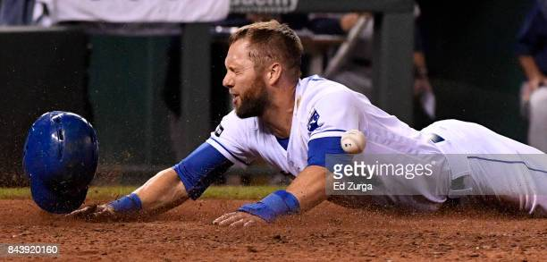 Alex Gordon of the Kansas City Royals slides into home to score against the Minnesota Twins in the fifth inning at Kauffman Stadium on September 7...