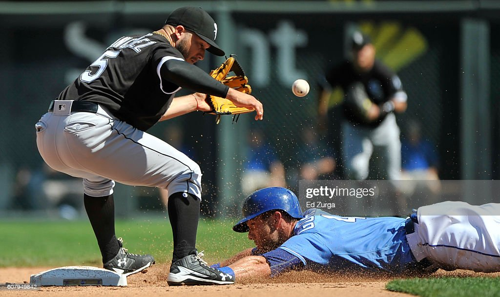 Alex Gordon #4 of the Kansas City Royals slides into second for a steal past Carlos Sanchez #5 of the Chicago White Sox in the fourth inning at Kauffman Stadium on September 19, 2016 in Kansas City, Missouri.