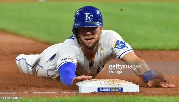 Alex Gordon of the Kansas City Royals slides into third as he advances on a Ryan McBroom single in the fifth inning at Kauffman Stadium on September...