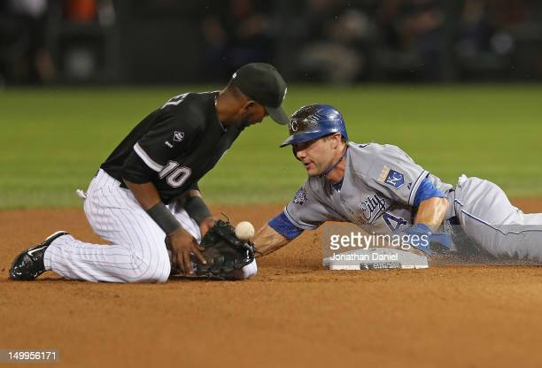 Alex Gordon of the Kansas City Royals steasl second base as Alexei Ramirez of the Chicago White Sox drops the ball at US Cellular Field on August 7...