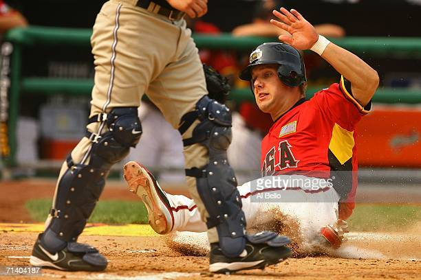 Alex Gordon of the U.S.A. Team slides into home to score against the World Team during the XM Satellite Radio All-Star Futures Game at PNC Park on...