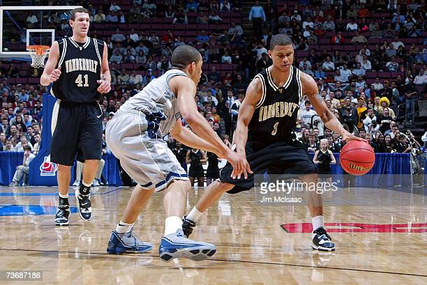 Alex Gordon of the Vanderbilt Commodores handles the ball while being defended by Jonathan Wallace of the Georgetown Hoyas during the NCAA Men's East...