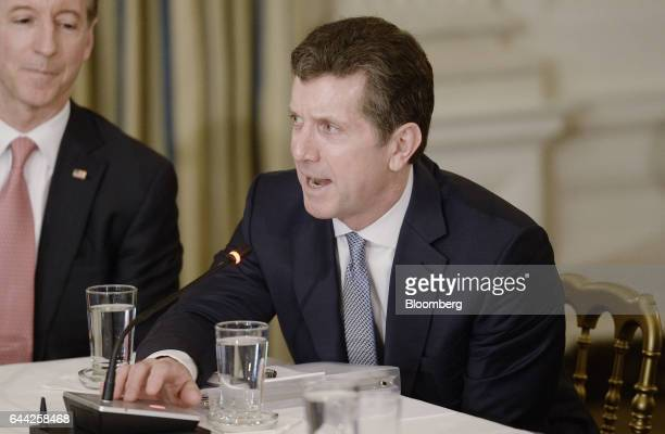 Alex Gorsky chairman and chief executive officer of Johnson Johnson speaks during a meeting with US President Donald Trump not pictured and...
