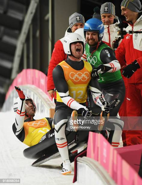 Alex Gough Sam Edney Tristan Walker and Justin Snith of Canada celebrate in the finish area during the Luge Team Relay on day six of the PyeongChang...