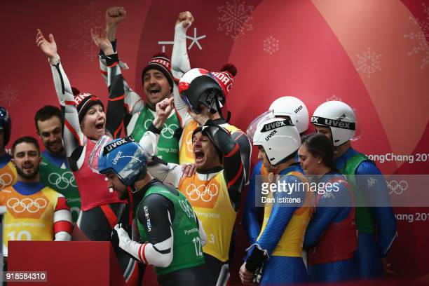 Alex Gough Sam Edney Tristan Walker and Justin Snith of Canada react during the Luge Team Relay on day six of the PyeongChang 2018 Winter Olympic...