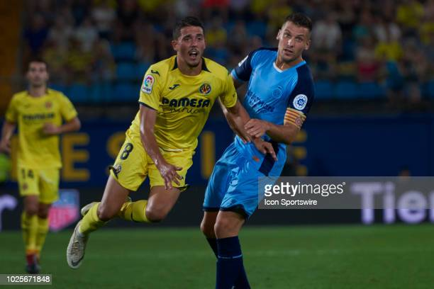 Alex Granell midfielder of Girona FC fouls Pablo Fornals midfielder of Villarreal CF during the La Liga match between Villarreal CF and Girona FC on...