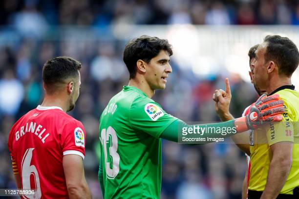 Alex Granell of Girona Bono of Girona referee Guillermo Cuadra Fernandez during the La Liga Santander match between Real Madrid v Girona at the...