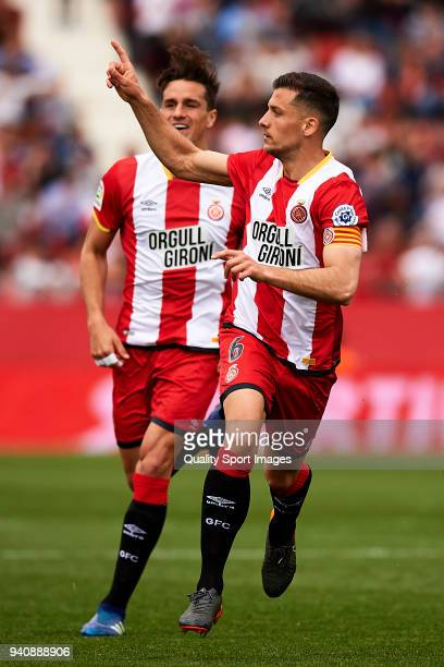 Alex Granell of Girona celebrates after scoring his sides first goal during the La Liga match between Girona and Levante at Estadio Montilivi on...