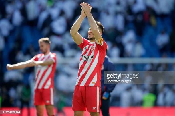 Alex Granell of Girona celebrates the victory during the La Liga Santander match between Real Madrid v Girona at the Santiago Bernabeu on February 17...