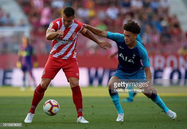 Alex Granell of Girona competes for the ball with Amos of Tottenham Hotspur during the preseason friendly match between Girona and Tottenham Hotspur...
