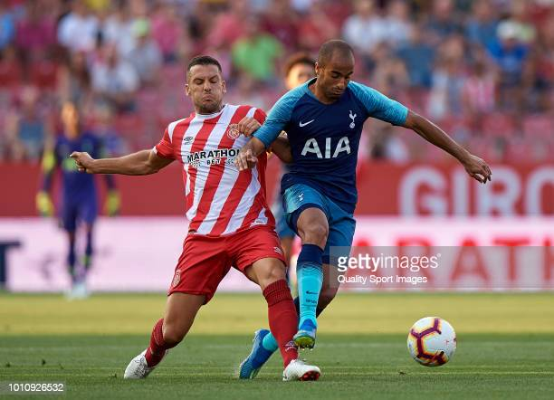 Alex Granell of Girona competes for the ball with Lucas Moura of Tottenham Hotspur during the preseason friendly match between Girona and Tottenham...