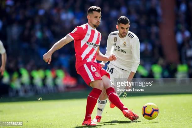Alex Granell of Girona Dani Ceballos of Real Madrid during the La Liga Santander match between Real Madrid v Girona at the Santiago Bernabeu on...
