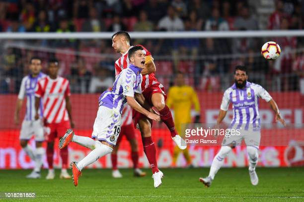 Alex Granell of Girona FC competes for the ball with Toni Villa of Real Valladolid CF during the La Liga match between Girona FC and Real Valladolid...