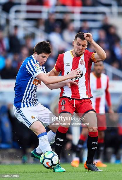 Alex Granell of Girona FC duels for the ball with Igor Zubeldia of Real Sociedad during the La Liga match between Real Sociedad de Futbol and Girona...