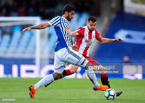 Alex Granell of Girona FC duels for the ball with Willian Jose Da Silva of Real Sociedad during the La Liga match between Real Sociedad de Futbol and...