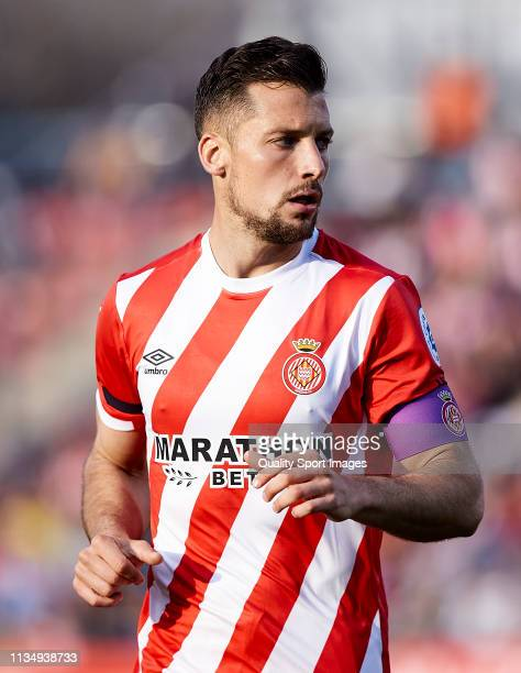 Alex Granell of Girona FC wears a purple armband captain during the La Liga match between Girona FC and Valencia CF at Montilivi Stadium on March 10...