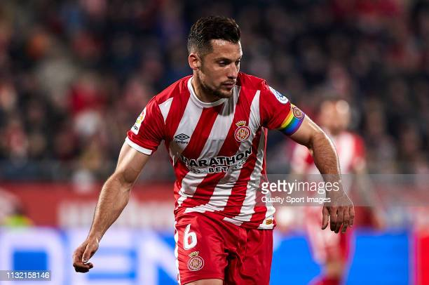 Alex Granell of Girona FC wears a rainbow coloured captain's armband during the La Liga match between Girona FC and Real Sociedad at Montilivi...