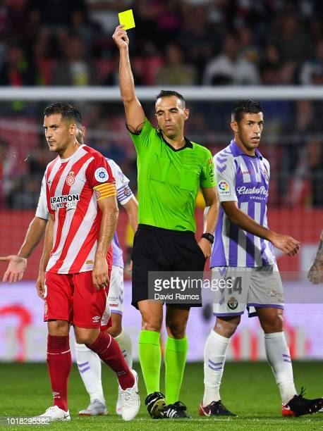 Alex Granell of Girona is shown a yellow card during the La Liga match between Girona FC and Real Valladolid CF at Montilivi Stadium on August 17...