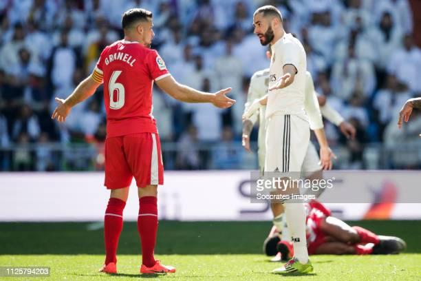 Alex Granell of Girona Karim Benzema of Real Madrid during the La Liga Santander match between Real Madrid v Girona at the Santiago Bernabeu on...