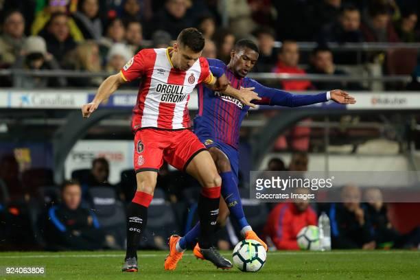 Alex Granell of Girona Nelson Semedo of FC Barcelona during the La Liga Santander match between FC Barcelona v Girona at the Camp Nou on February 24...