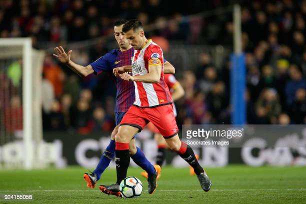Alex Granell of Girona Sergio Busquets of FC Barcelona during the La Liga Santander match between FC Barcelona v Girona at the Camp Nou on February...