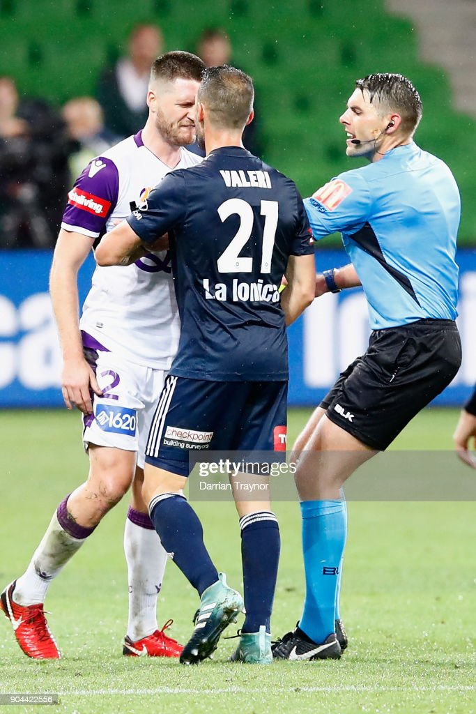 Alex Grant of Perth Glory and Carl Valeri of Melbourne Victory argue during the round 16 A-League match between the Melbourne Victory and Perth Glory at AAMI Park on January 13, 2018 in Melbourne, Australia.