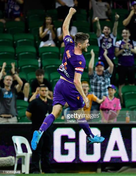 Alex Grant of the Glory celebrates scoring a goal with team mates during the round 10 ALeague match between the Perth Glory and the Western Sydney...