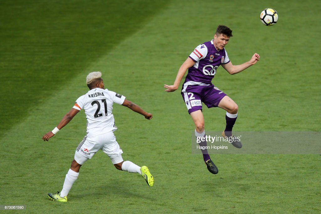Alex Grant of the Glory heads the ball under pressure from Roy Krishna of the Phoenix during the round six A-League match between the Wellington Phoenix and the Perth Glory at Westpac Stadium on November 12, 2017 in Wellington, New Zealand.