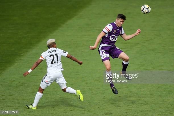 Alex Grant of the Glory heads the ball under pressure from Roy Krishna of the Phoenix during the round six ALeague match between the Wellington...
