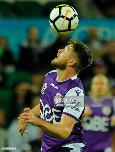 Alex Grant of the Perth Glory looks to head the ball during the round 27 ALeague match between the Perth Glory and the Brisbane Roar at nib Stadium...