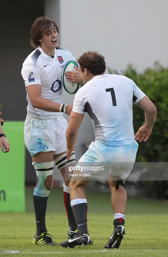 Alex Gray (L) of England is congratulated by team mate Matt Everard after scoring the final try during the IRB Junior World Championship match between England and France at the Stadio Communale di Monigo on June 22, 2011 in Treviso, Italy.