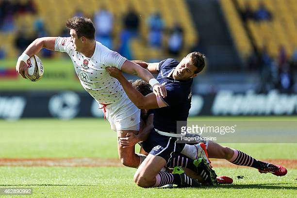 Alex Gray of England is tackled by Darren Gillespie of Scotand during the cup semifinal match between Scotland and England in the 2015 Wellington...