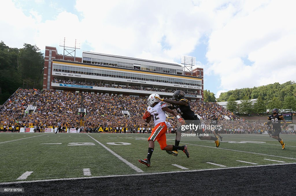 Alex Gray #3 of the Appalachian State Mountaineers tries to tackle Ahmmon Richards #82 of the Miami Hurricanes during their game at Kidd Brewer Stadium on September 17, 2016 in Boone, North Carolina.