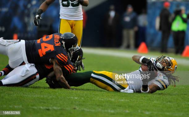 Alex Green of the Green Bay Packers is tackled by Kelvin Hayden of the Chicago Bears on December 16 2012 at Soldier Field in Chicago Illinois The...