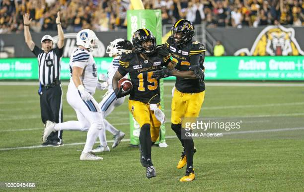 Alex Green of the Hamilton TigerCats celebrates a touchdown against the Toronto Argonauts in a CFL game at Tim Hortons Field on September 3 2018 in...