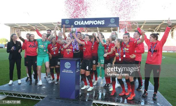 Alex Greenwood and Amy Turner of Manchester United Women lift the FA Women's Championship trophy after the WSL match between Manchester United Women...