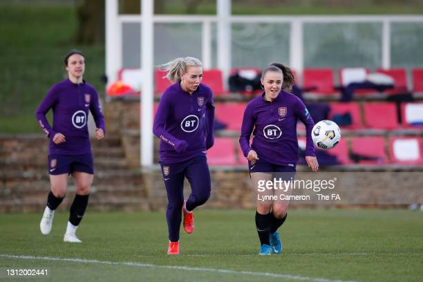 Alex Greenwood and Georgia Stanway of England react during an England Training Session in preparation for an upcoming International match at St...