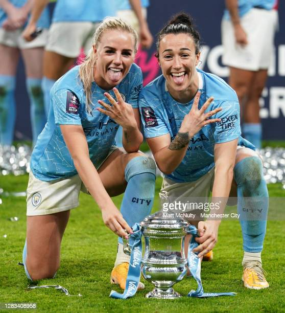 Alex Greenwood and Lucy Bronze of Manchester City celebrate with the trophyduring the Vitality Women's FA Cup Final match between Everton Women and...