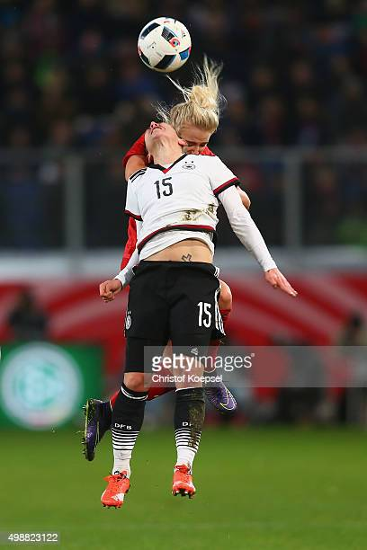 Alex Greenwood of England and Anna Blaesse of Germany go up for a header during the Women's International Friendly match between Germany and England...