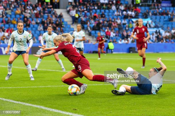 Alex Greenwood of England goes down under the challenge of Ruth Bravo of Argentina to win a penalty during the 2019 FIFA Women's World Cup France...