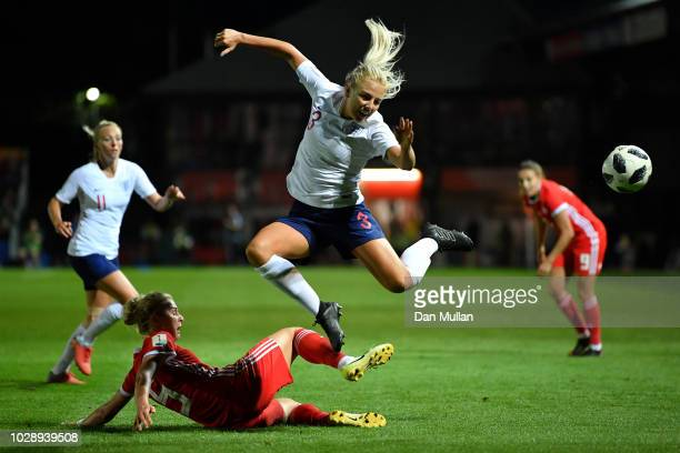 Alex Greenwood of England is tackled by Rhiannon Roberts of Wales during the Women's World Cup qualifier between Wales Women and England Women at...