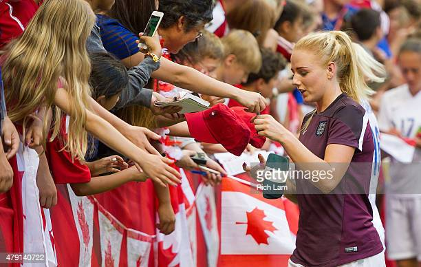 Alex Greenwood of England signs autographs for fans after the FIFA Women's World Cup Canada 2015 Quarter Final match between the England and Canada...