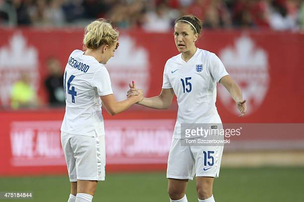 Alex Greenwood of England talks to Casey Stoney against Canada during their Women's International Friendly match on May 29 2015 at Tim Hortons Field...