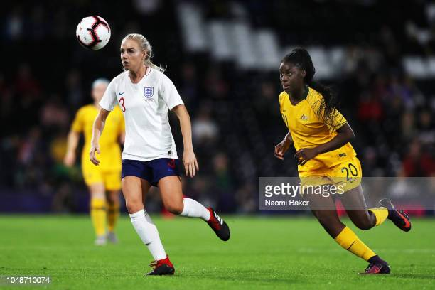 Alex Greenwood of England Women battles for posession with Princess IbiniIsei of Australia during the International Friendly match between England...